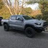 Joe's '17 Tacoma TRD Pro w/ Bilstein 8112 Series Coilovers and Rear Bypass shocks, Total Chaos Upper Control Arms, and Needle Bearing Delete Kit.  Rolling on Nitto Ridge Grapplers and Method Race Wheels.  Truck Required the cab mount chop mod which was custom plated in house.